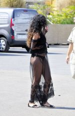 RIHANNA in Racy Sheer Skirt at a Airport in France