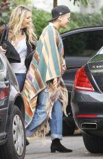 RITA ORA Wearing a Poncho Out in London