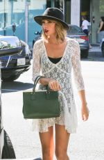 TAYLOR SWIFT Arrives at Honor Bar in Beverly Hills