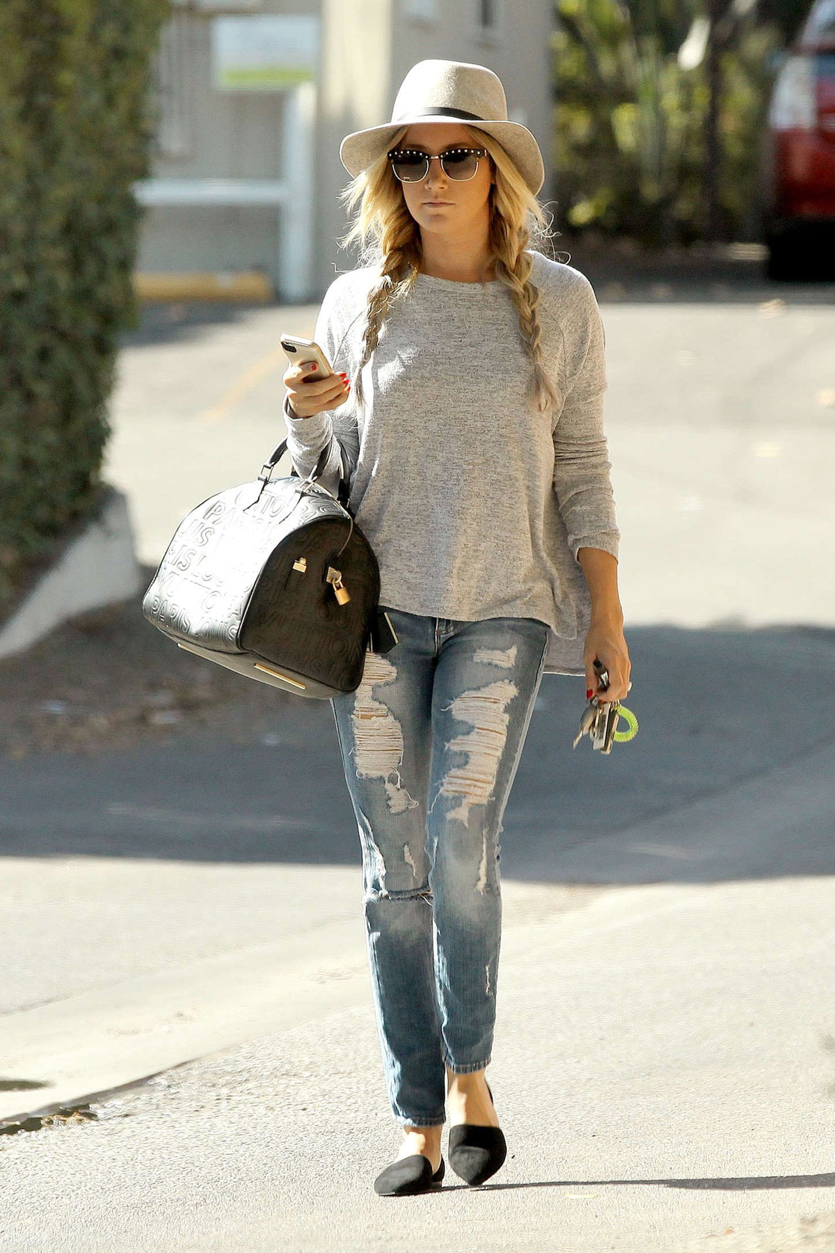 ASHLEY TISDALE in Ripped Jeans Out and About in Studio ...