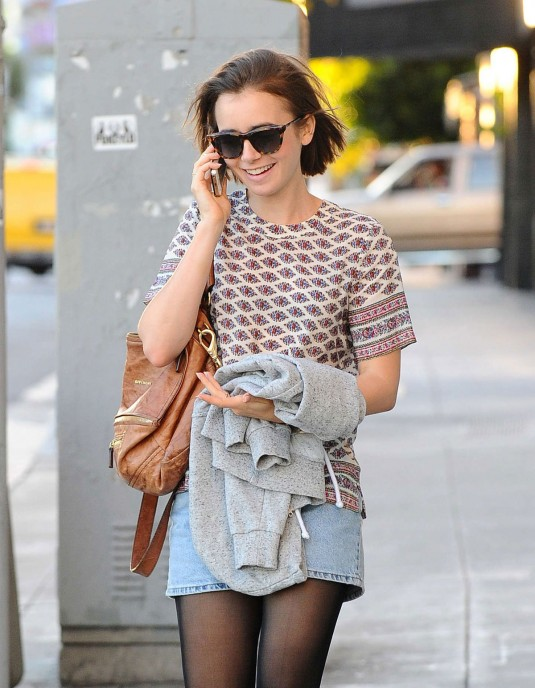 LILY COLLINS in Knee Boots and Shorts