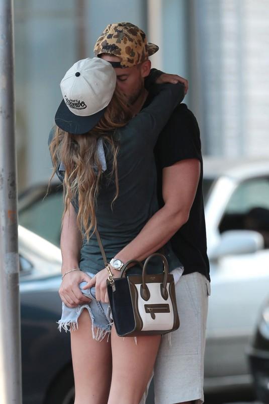 NINA AGDAL and Reid Heidenry Kissing