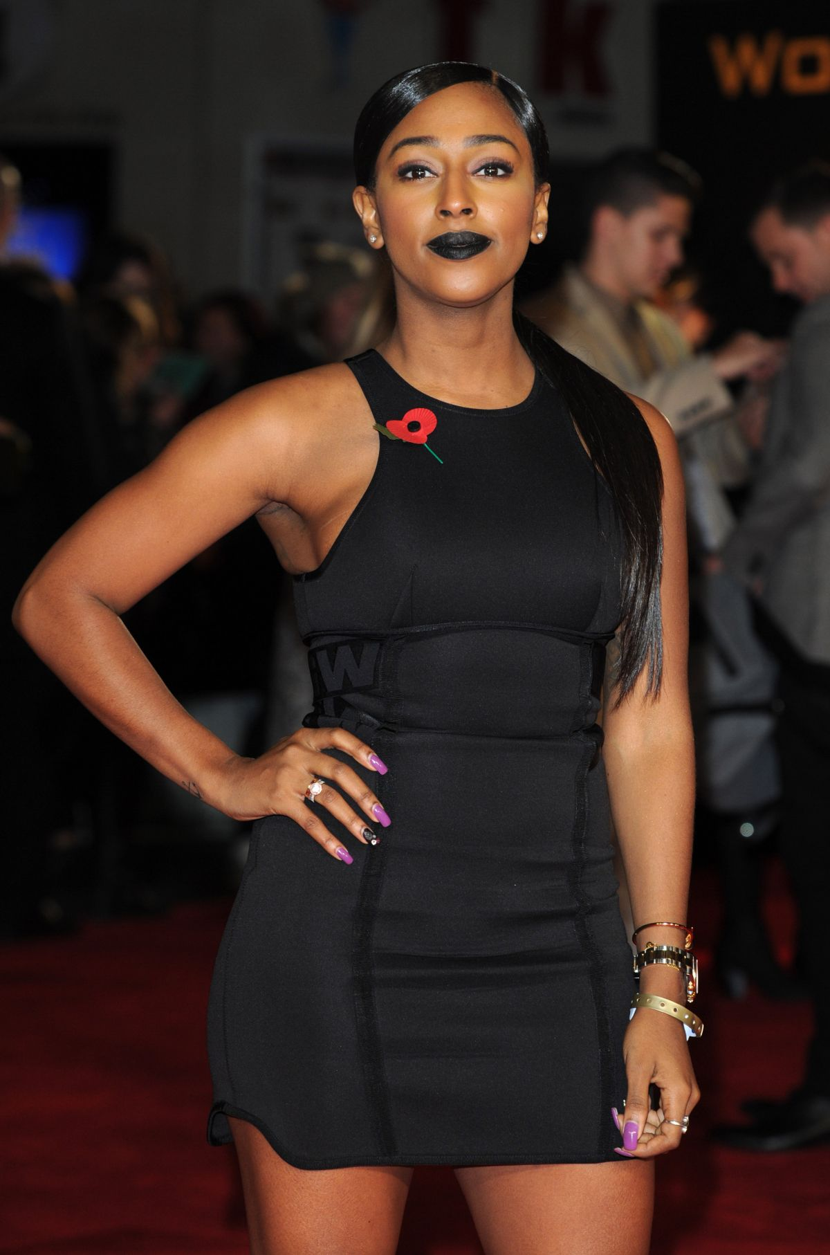 ALEXANDRA BURKE at The Hunger Games: Mockingjay Part 1 Premiere in London