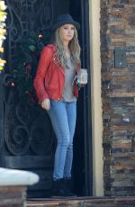 ASHLEY TISDALE in Jeans at Her Home in Toluca Lake 2011