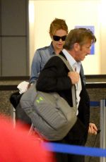 CHARLIZE THERON and Sean Penn Arrives at LAX Airport