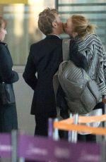 CHARLIZE THERON and Sean Penn Share a Kiss at LAX Airport