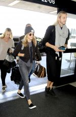 CHLOE and Trevor MORETZ at LAX Airport in Los Angeles