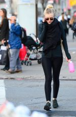 DAKOTA FANNING in Tights Out and About in New York