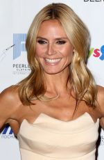 HEIDI KLUM at 2014 K.I.D.S./Fashion Delivers Gala in New York