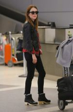 JULIENNA MOORE Arrives at Los Angeles International Airport