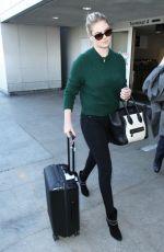 KATE UPTON Arrives at Los Angeles International Airport 1611