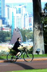 KATY PERRY in Tights Riding a Bicycle Out in Perth