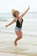 KENDRA WILKINSON in Swimsuit at a Phostoshoot on the Beach in Queensland