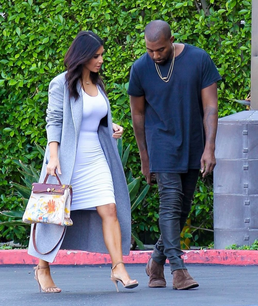 KIM KARDASHIAN and Kanye West Arrives at Jenner cCommunications in