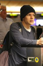 MIA WASIKOWSKA and Jesse Eisenberg Arrives at LAX Airport in Los Angeles