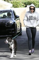 MILEY CYRUS Walks Her Dog Out in Los Angeles