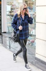 NICKY HILTON Feeding a Parking Meter in Beverly Hills