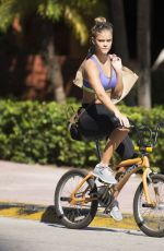 NINA AGDAL in Sport Bra and Leggings Riding a Bike Out in Miami