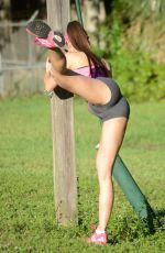ANAIS ZANOTTI Doing Yoga at a Park in Miami