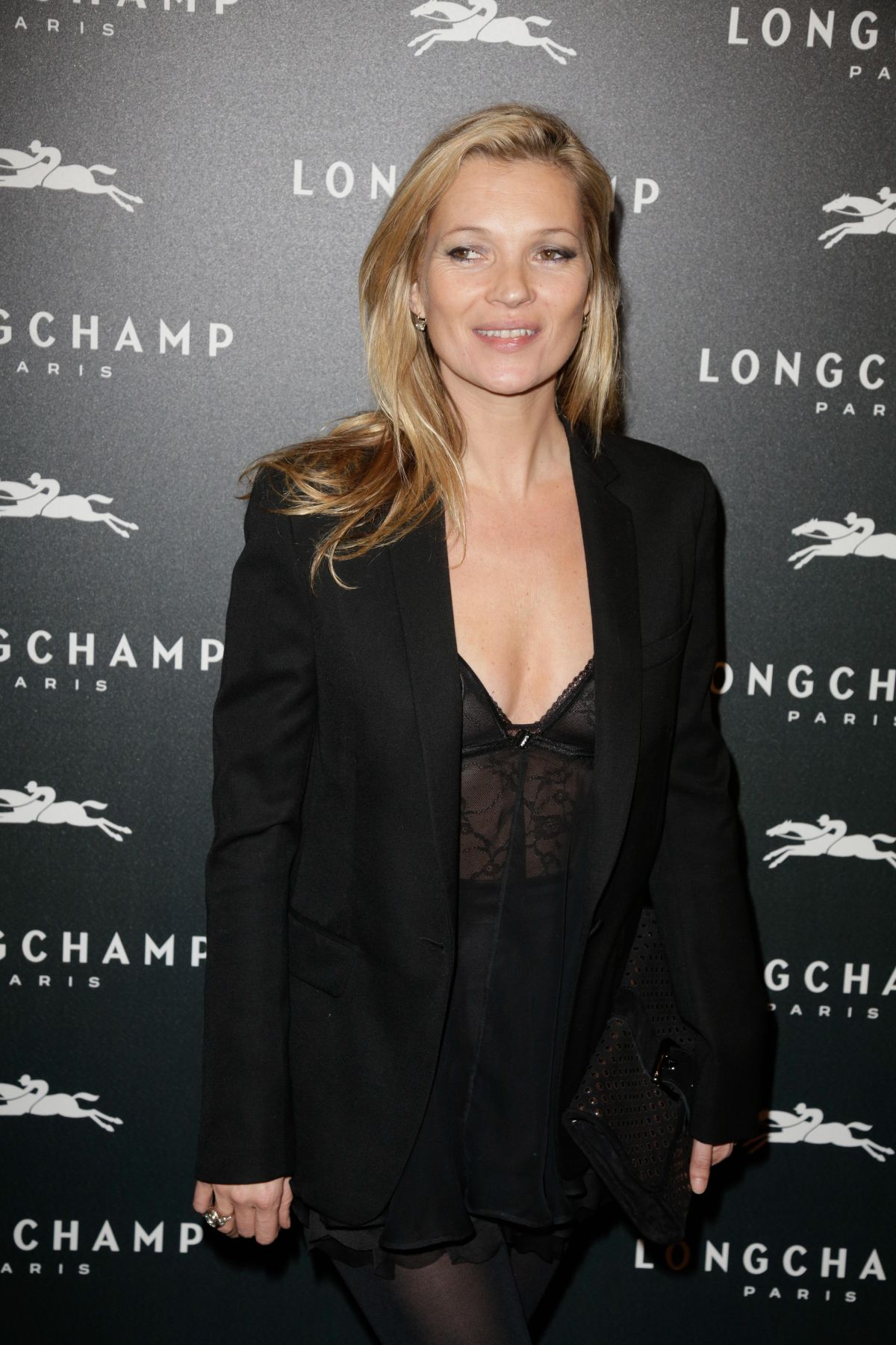 KATE MOSS at Longchamp Elysees Light On Party Photocall in Paris