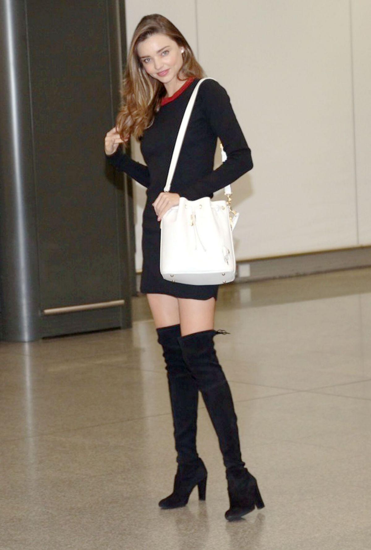 MIRANDA KERR in Over Knee Boots at Hong Kong International Airport