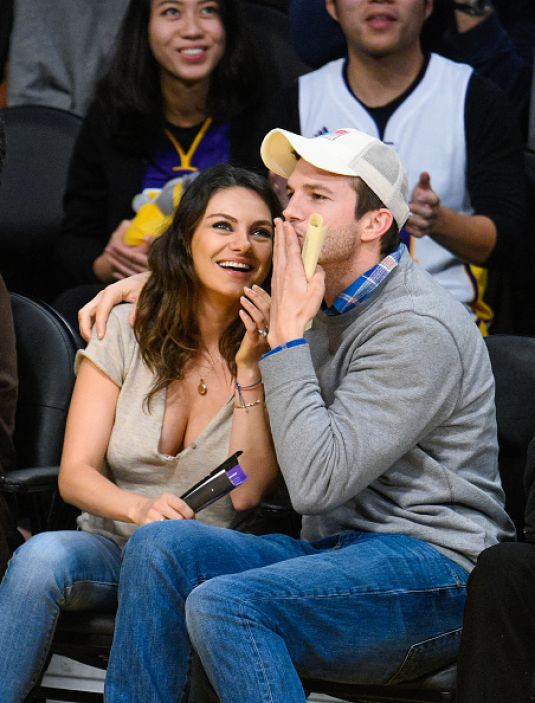 Pregnant MILA KUNIS and Ashton Kutcher at LA Lakers Game in Los Angeles