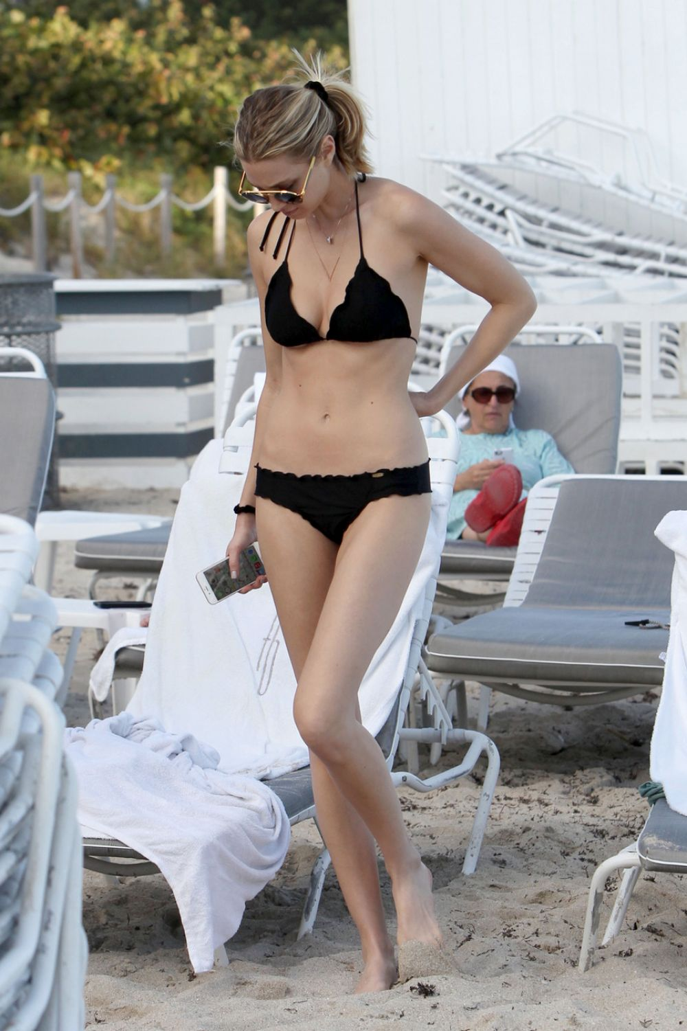 Whitney port struggles to contain her curves in a bikini as she splashes around the sea