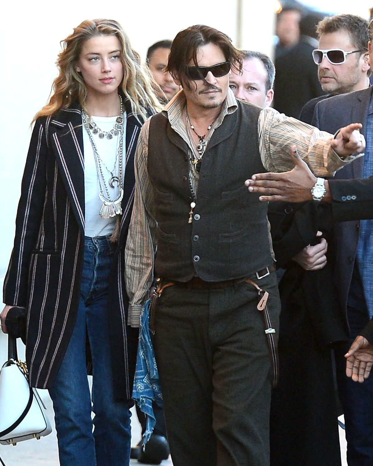 http://www.hawtcelebs.com/wp-content/uploads/2015/01/amber-heard-and-johnny-depp-arrives-at-jimmy-kimmel-live_1.jpg