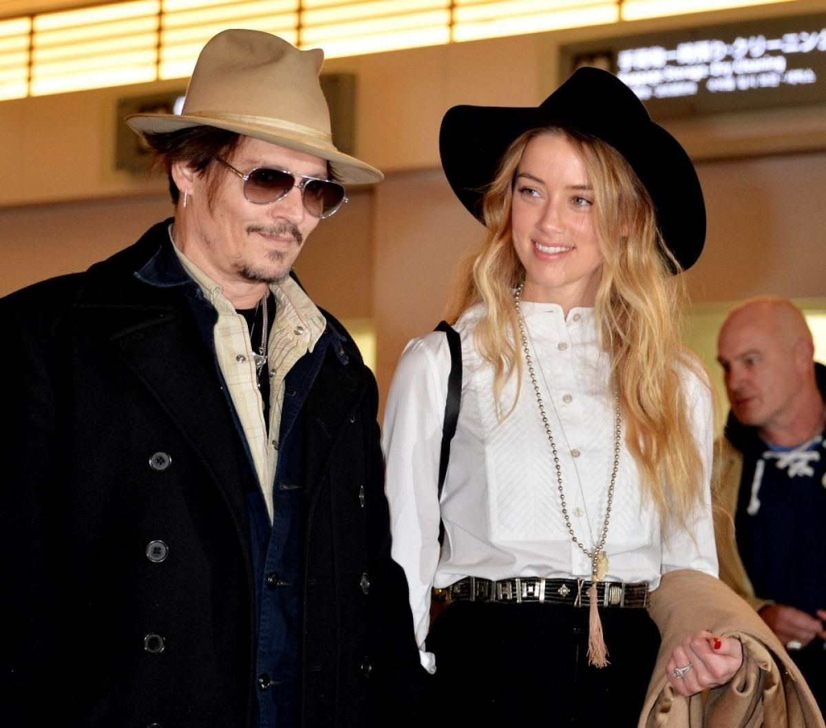 AMBER HEARD and Johnny Depp Arrives at Tokyo International Airport