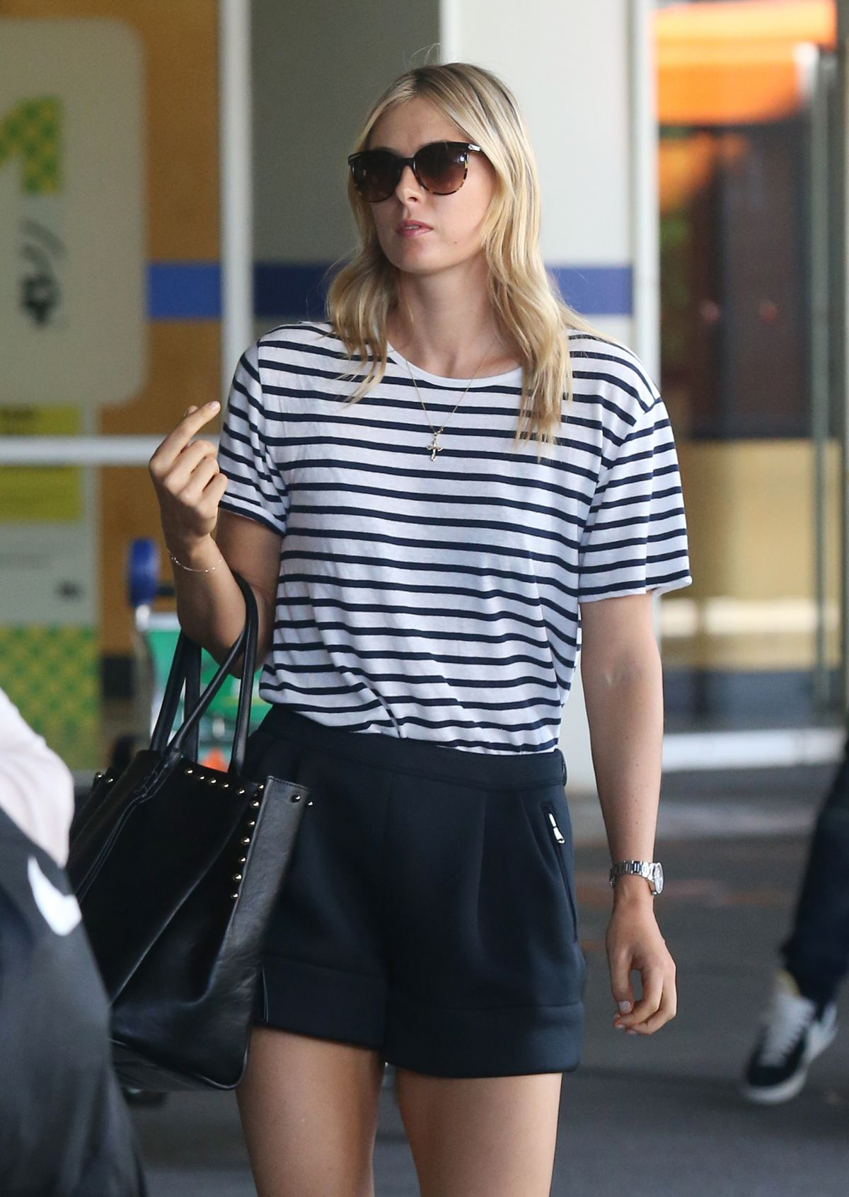 MARIA SHARAPOVA Arrives at Airport in Melbourne
