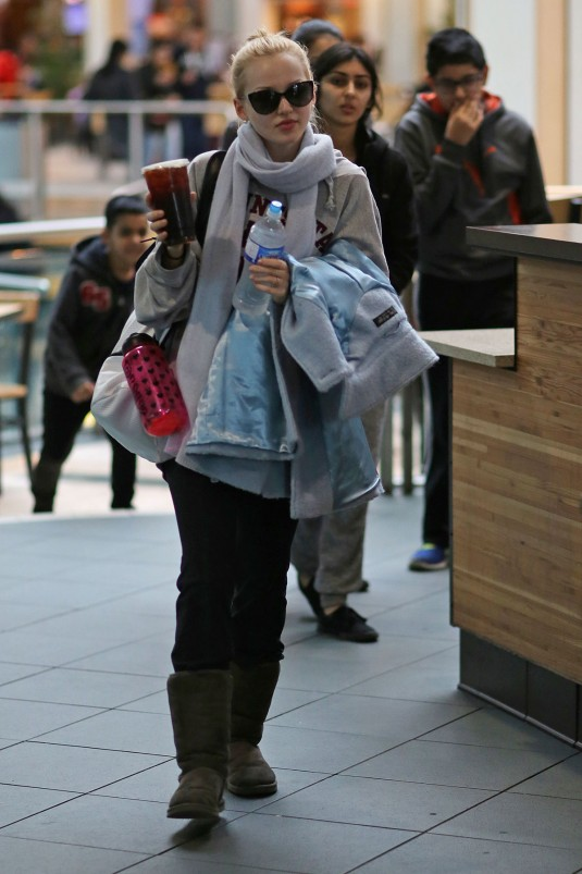 DOVE CAMERON Arrives at Vancouver Airport