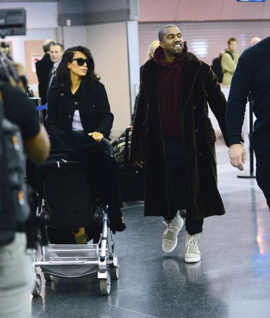 KIM KARDASHIAN and Kanye West at JFK Airport
