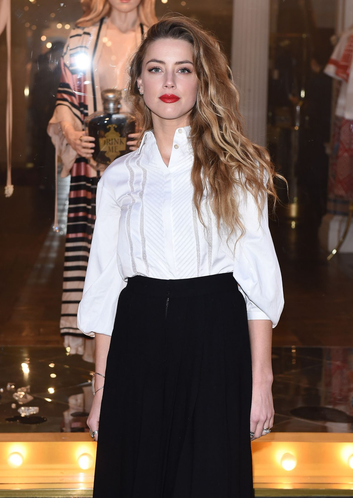 AMBER HEARD Unveils Alice in Wonderland Themed Window in London