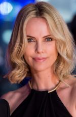 CHARLIZE THERON at The Gunman Premiere in London