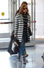 EVA MENDES Arrives at JFK Airport in New York 2002