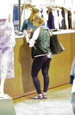 HILARY DUFF Shoping at Intermix in Los Angeles