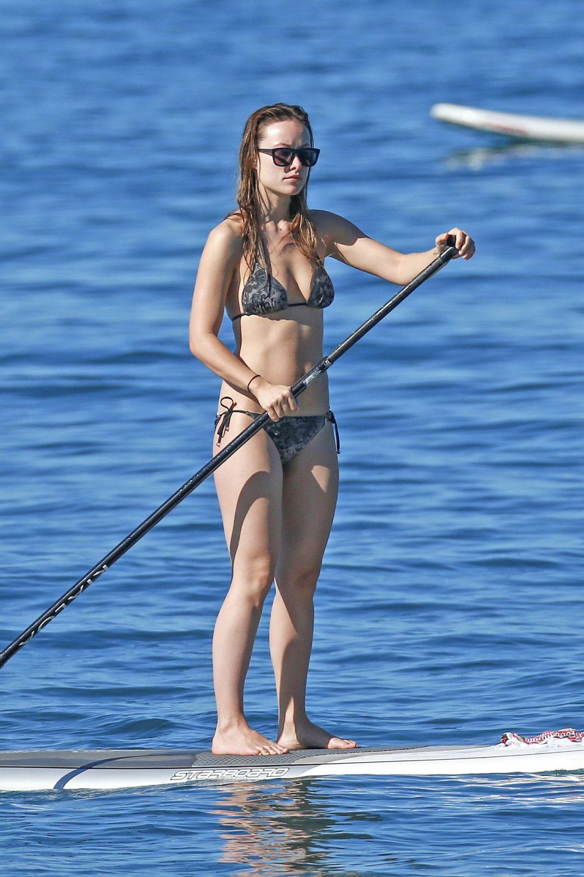 OLIVIA WILDE in Bikini Paddleboarding in Maui