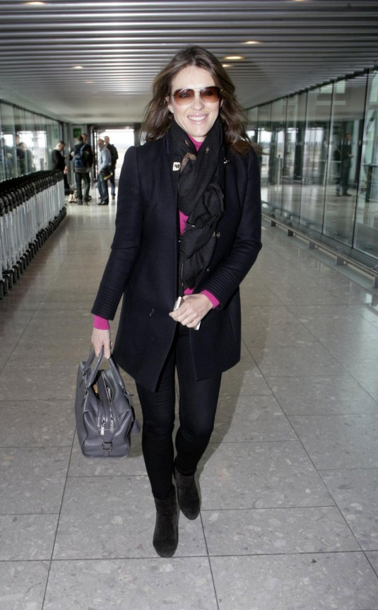 ELIZABETH HURLEY Arrives at Heathrow Airport