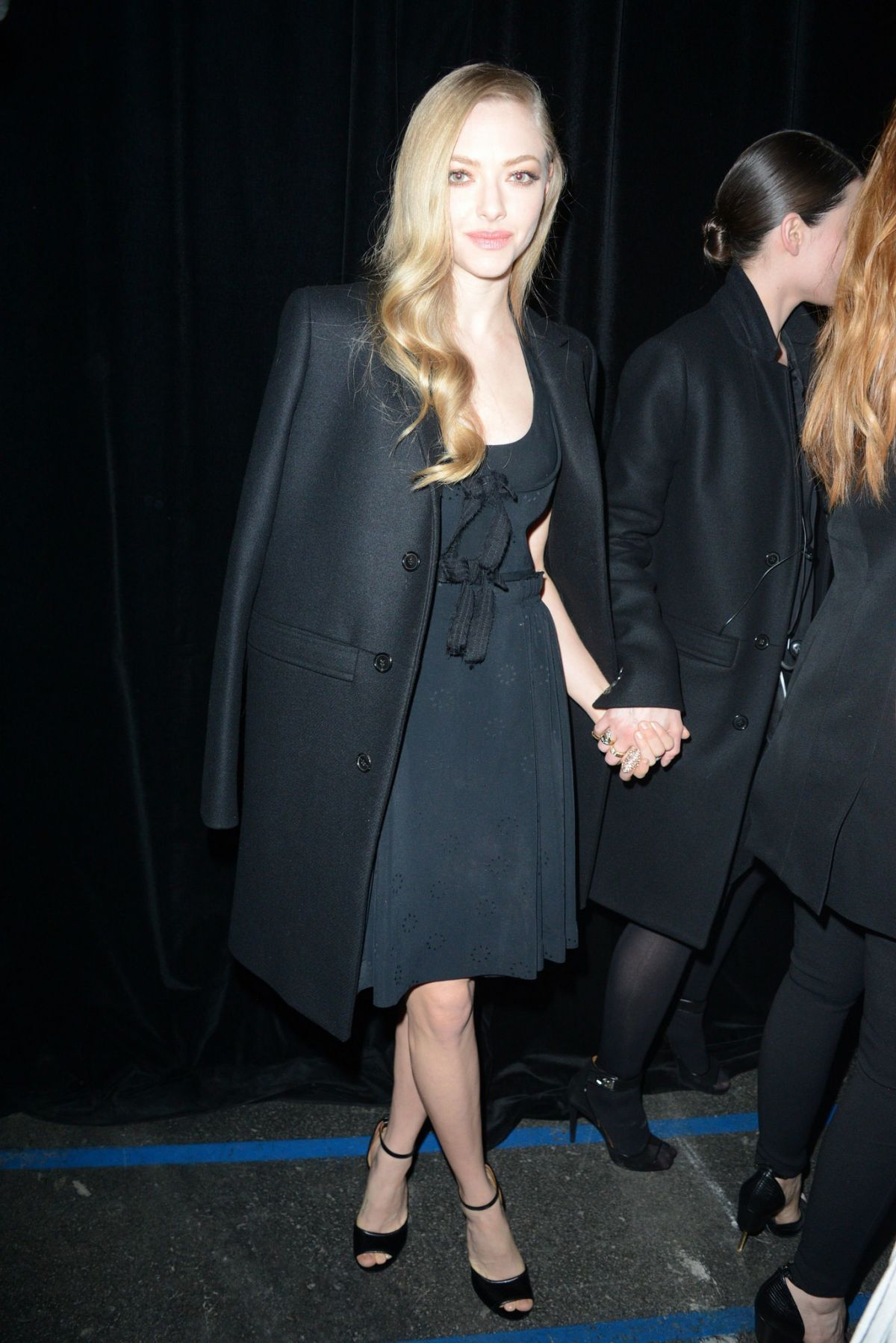 AMANDA SYEFRIED Arrives at Givenchy Fashion Show in Paris