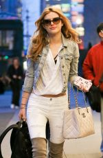 BELLA THORNE in Over-the-knee Boots at JFK Airport in New York