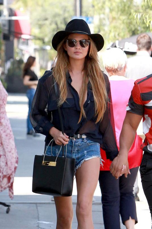 CHRISSY TEIGEN in Jeans Shorts