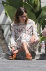 ALEXA CHUNG Taking a Break During a Photoshoot in Los Angeles