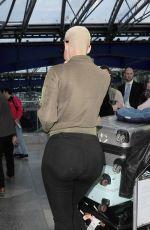 AMBER ROSE at Heathrow Airport in London 04/20/2015