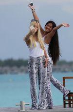 AVA SAMBORA in Bikini Paddleboarding in Bora Bora