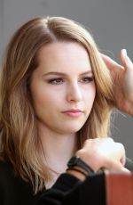 BRIDGIT MENDLER on the Set of Extra in Los Angles
