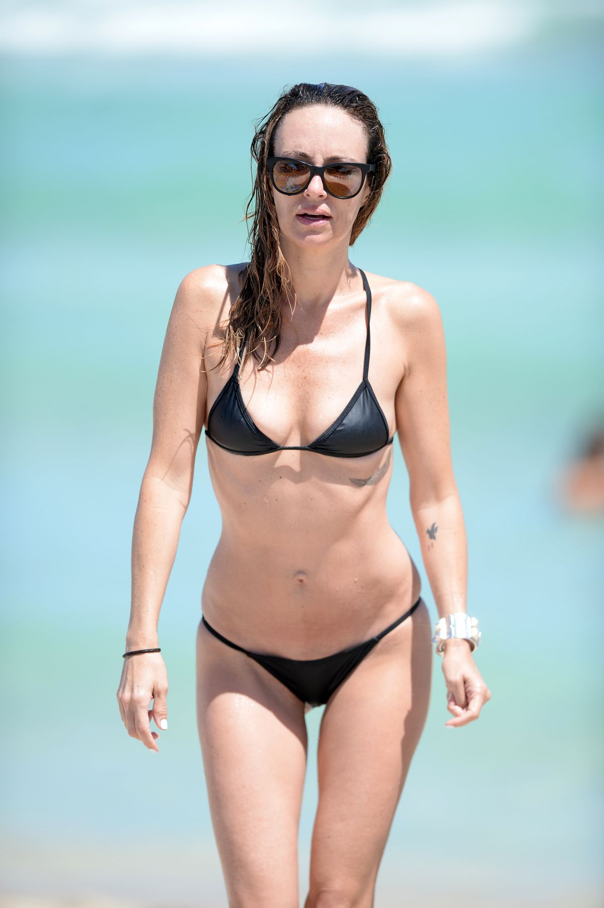 CATT SADLER in Bikini on the Beach in Miami