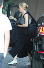 CHARLIZE THERON Arrives at Chateau Marmont in West Hollywood 04/28/2015
