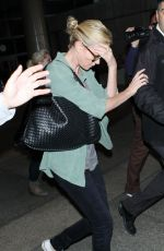 CHARLIZE THERON Arrives at LAX Airport in Los Angeles