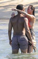CHRISSY TEIGEN in Bikini on the Beach in The Caribbean
