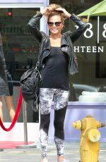 CHRISSY TEIGEN Waiting For a Car in Beverly Hills